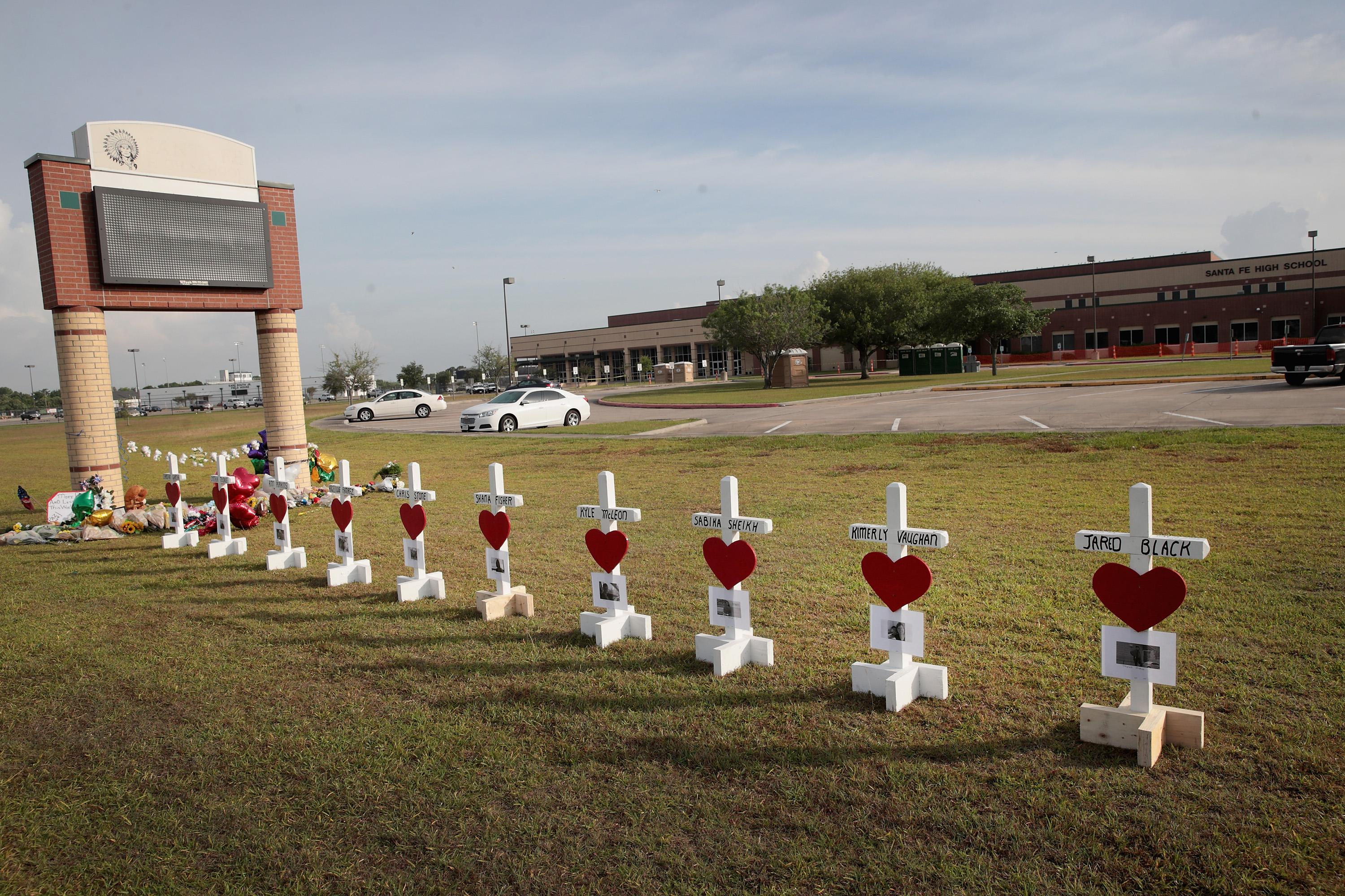 Crosses line the lawn in front of Santa Fe High School in Texas.