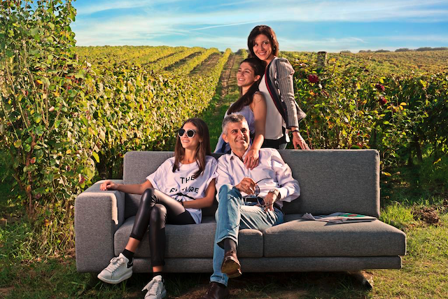 Piero Mastroberardino sitting with family in vineyard.