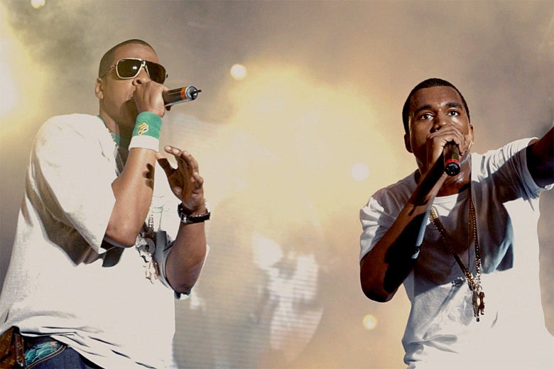 Jay-Z and Kanye West performing on stage.