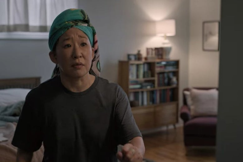 Dr. Kim with her hair wrapped in a towel, sitting on her bed.