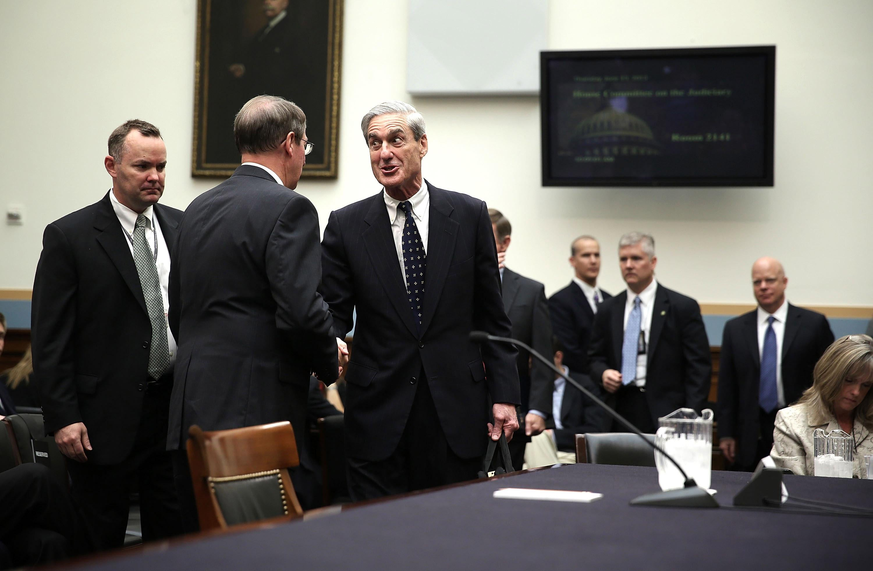 Robert Mueller shakes hands with committee chairman Rep. Bob Goodlatte as he arrives at a hearing before the House Judiciary Committee June 13, 2013 on Capitol Hill in Washington, DC.