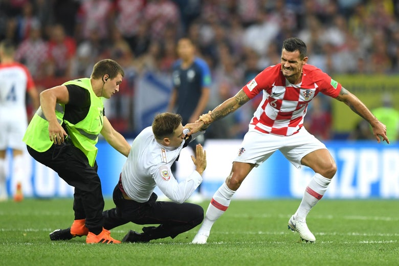MOSCOW, RUSSIA - JULY 15:  Dejan Lovren of Croatia confronts a pitch invader during the 2018 FIFA World Cup Final between France and Croatia at Luzhniki Stadium on July 15, 2018 in Moscow, Russia.  (Photo by Shaun Botterill/Getty Images)