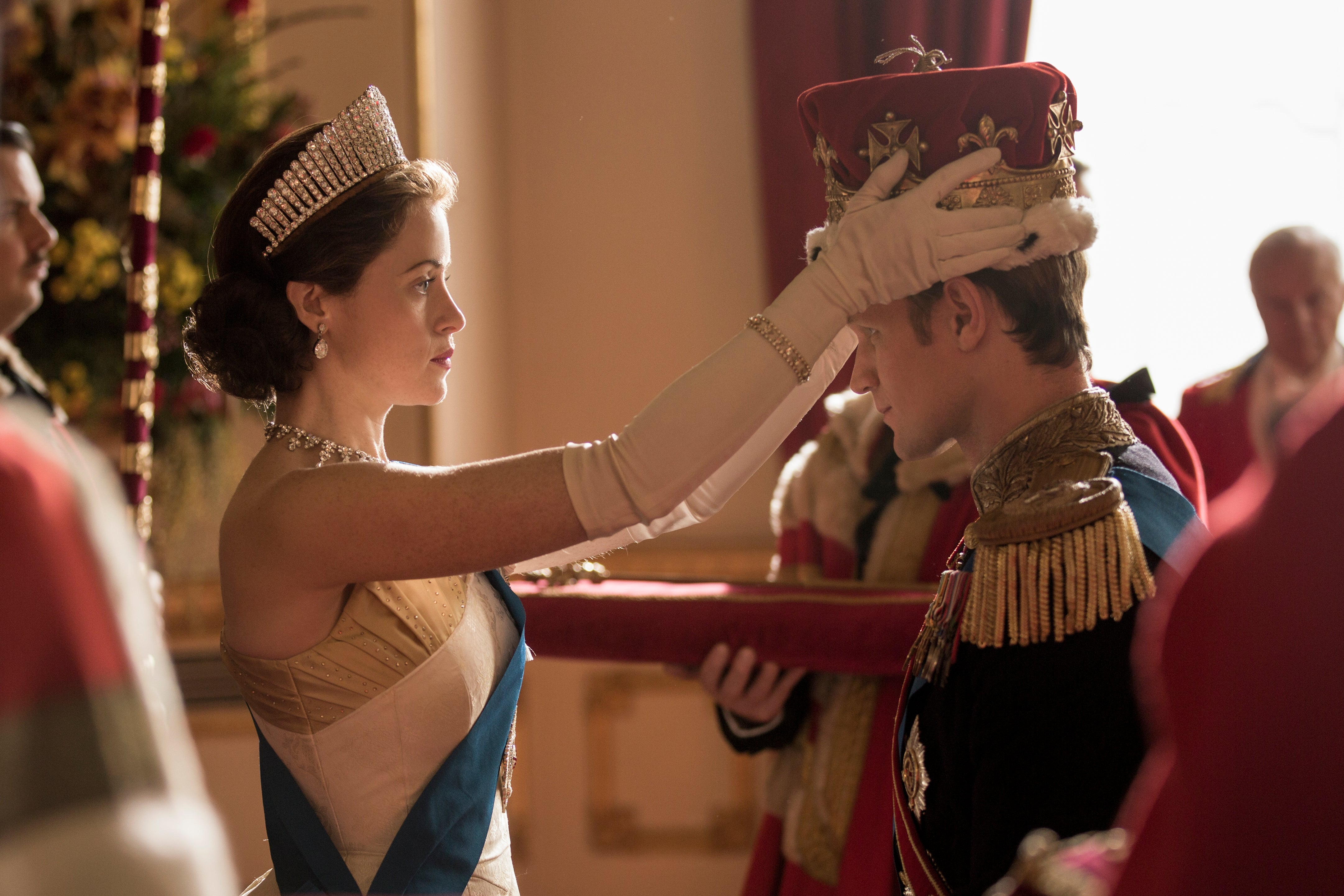 Claire Foy as Queen Elizabeth crowns Matt Smith as Prince Philip.