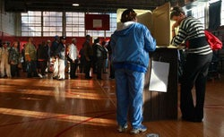 African-Americans line up to vote in a school gymnasium in the presidential election November 4, 2008 in Birmingham, Alabama.