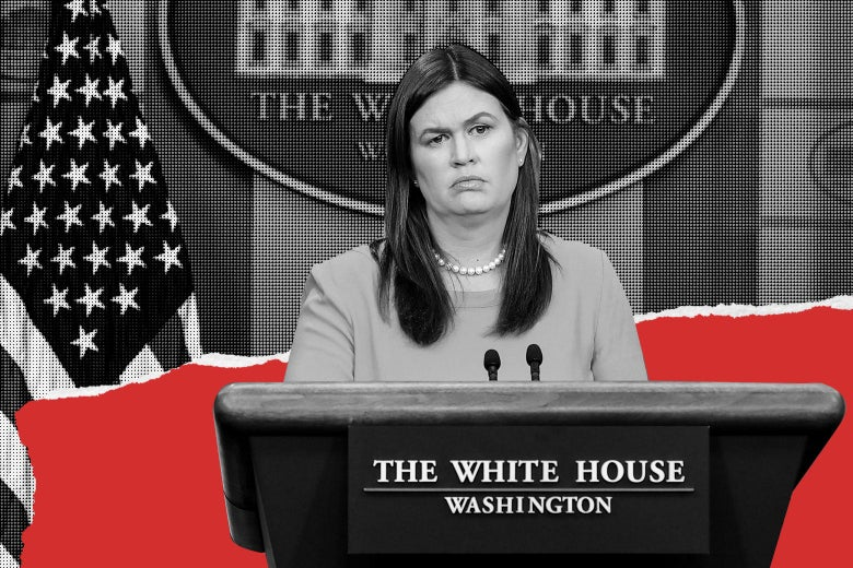 Sarah Huckabee Sanders stands at the podium in the White House press briefing room.