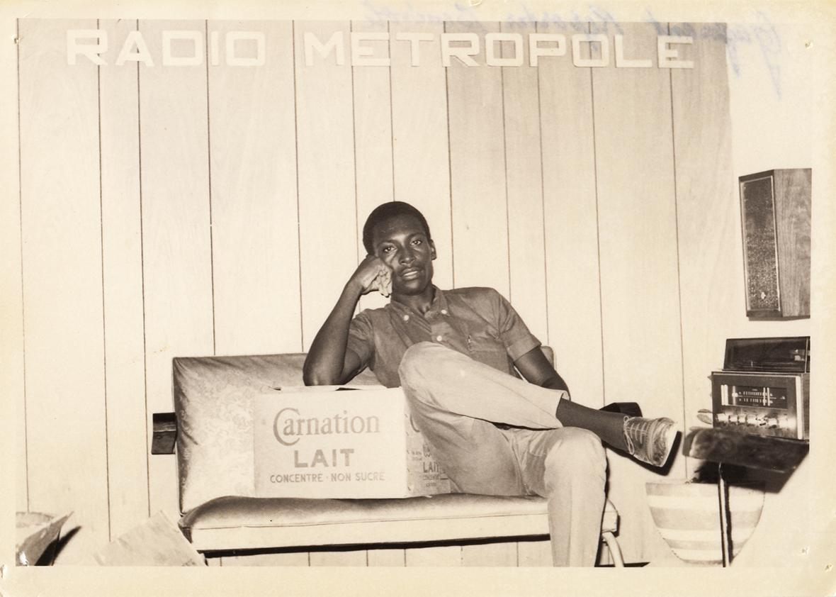 A radio technician poses for a photo at the original studios of Radio Metropole. 1960s.