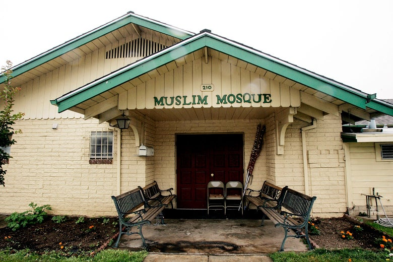 "A building that says ""Muslim Mosque"" over the awning."