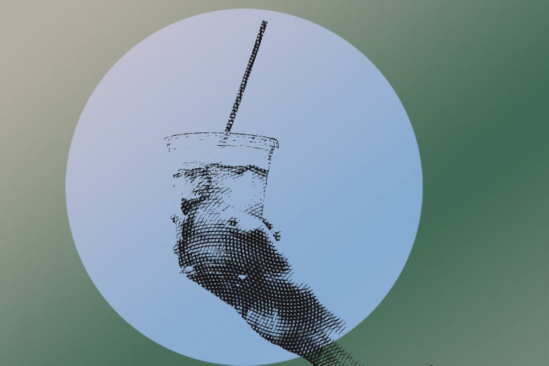 Hand holding a plastic to-go up of iced tea