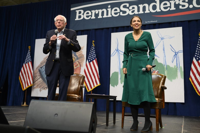 Democratic Presidential candidate Bernie Sanders and Rep. Alexandria Ocasio-Cortez field questions from audience members at the Climate Crisis Summit at Drake University on November 9, 2019 in Des Moines, Iowa.