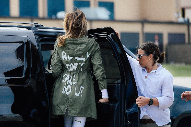 "First lady Melania Trump departs Joint Base Andrews in Maryland on Thursday while wearing a jacket with the words ""I really don't care, do you?"" Her back is to the camera as she enters a vehicle."