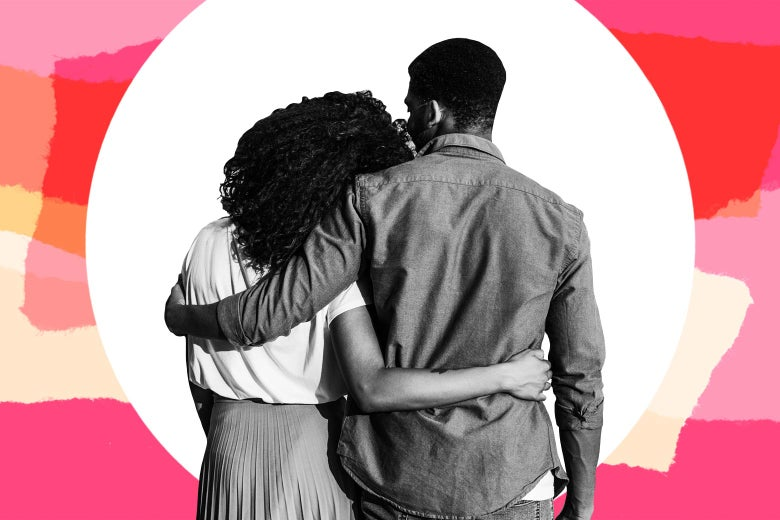 A black man and woman seen from behind with their arms around each other.