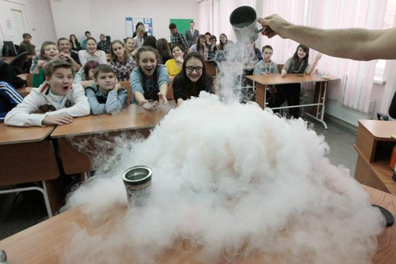 Pupils watch the effect produced by liquid nitrogen during a demonstration at a local grammar school in Russia's Siberian city of Krasnoyarsk, Russia on November 21, 2012.