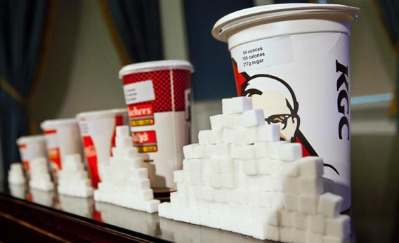 A 64-ounce drink is displayed alongside other soft drink cup sizes at a news conference at City Hall in New York, May 31, 2012.