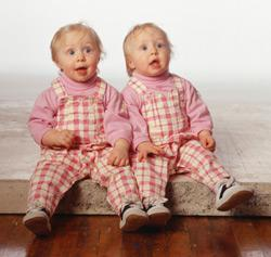 Twins dressed in matching outfits. Click image to expand.