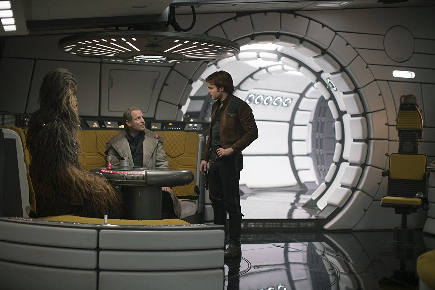 Chewbacca, Woody Harrelson as Tobias Beckett, and Alden Ehrenreich as Han Solo, aboard the Millennium Falcon