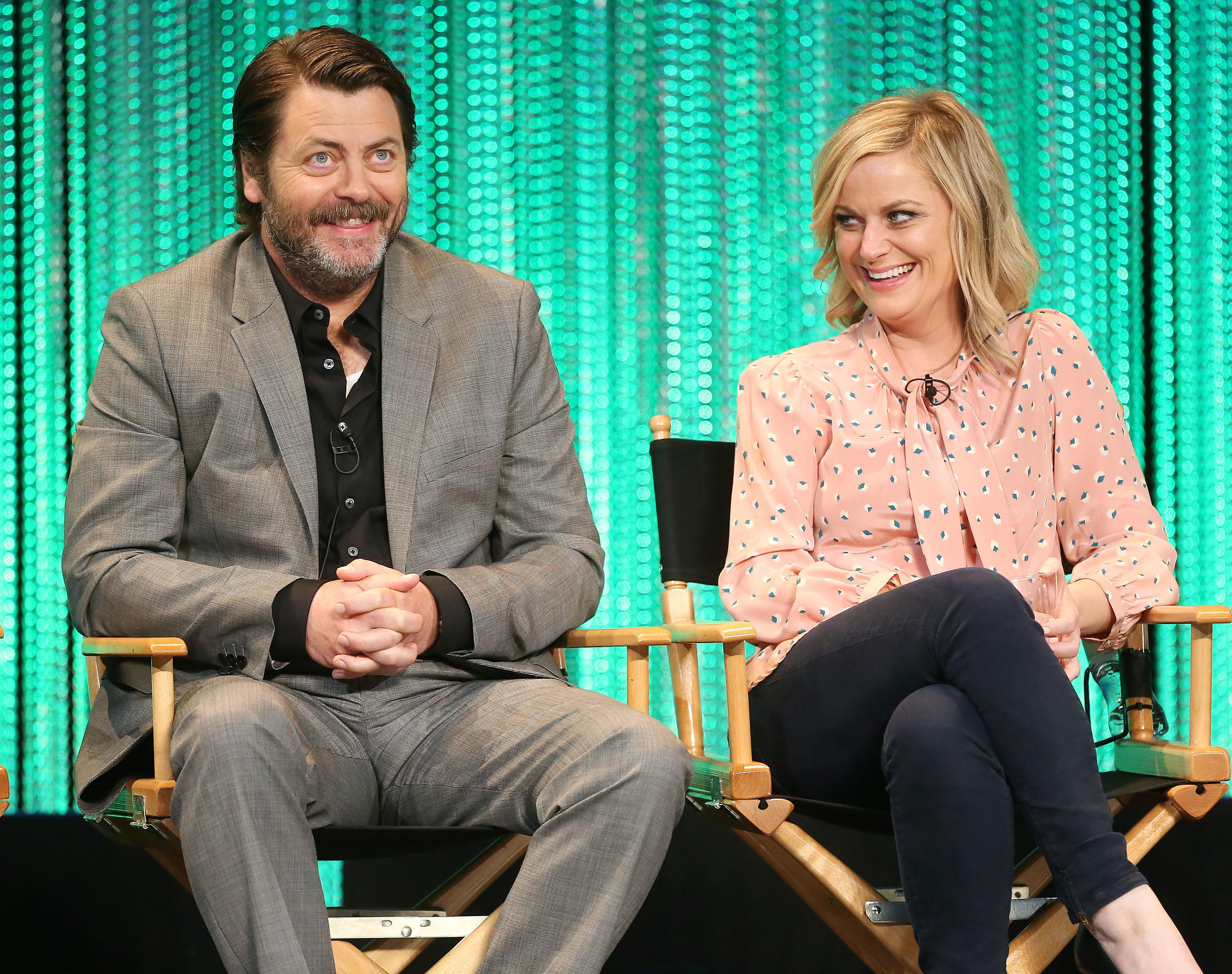HOLLYWOOD, CA - MARCH 18: Actor Nick Offerman (L) and actress Amy Poehler speak during The Paley Center for Media's PaleyFest 2014 Honoring 'Parks and Recreation' at the Dolby Theatre on March 18, 2014 in Hollywood, California.  (Photo by Frederick M. Brown/Getty Images)