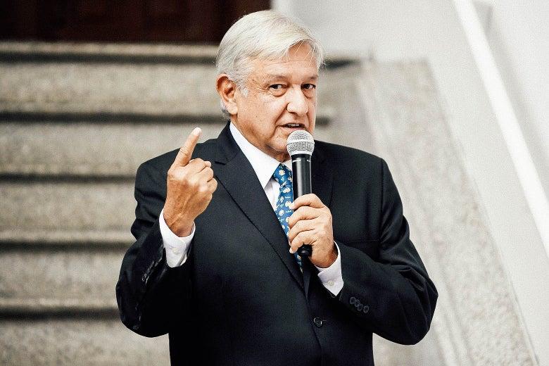 Mexico President-elect Andrés Manuel López Obrador speaking into a mic.