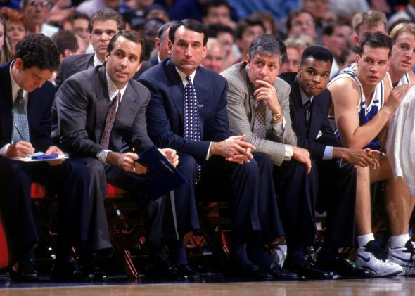 Head coach Mike Krzyzewski, center, of the Duke University Blue Devils sits with his assistants during a NCAA game against the University of Illinois.