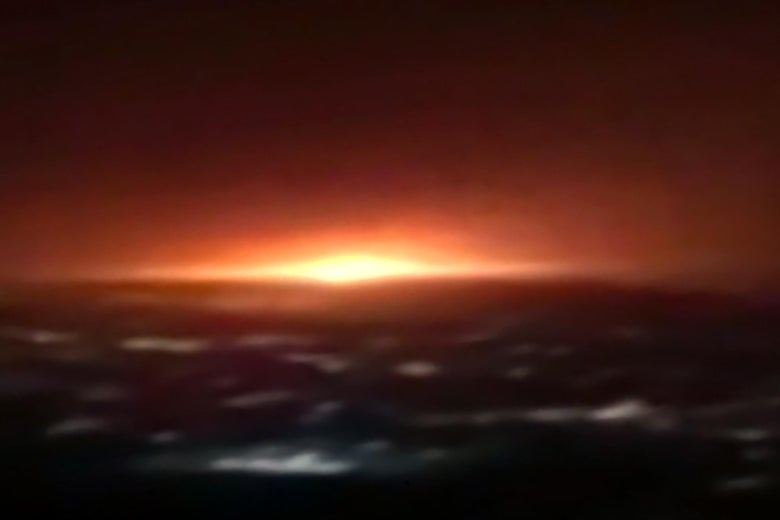 Blurry screen capture of an explosion in the night sky.