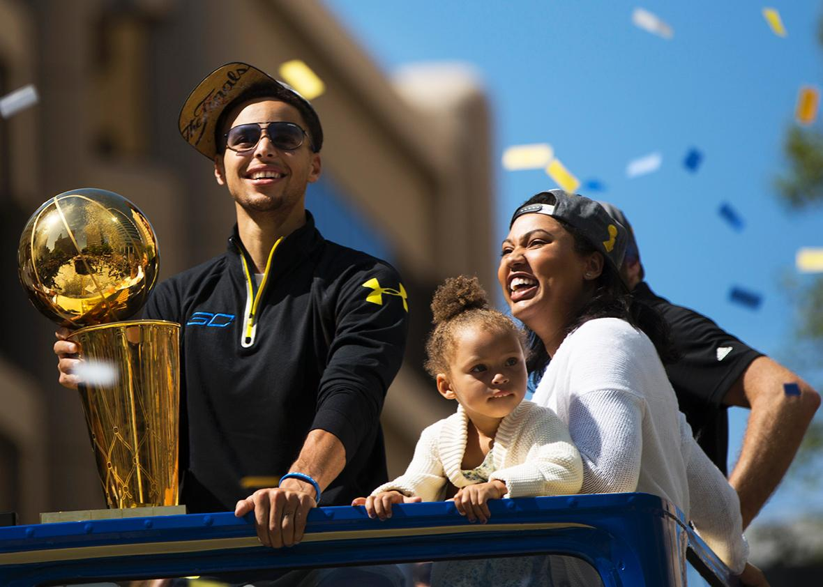 Stephen Curry #30 of the Golden State Warriors, daughter Riley and wife Ayesha smile during the Golden State Warriors Victory Parade in Oakland, California.