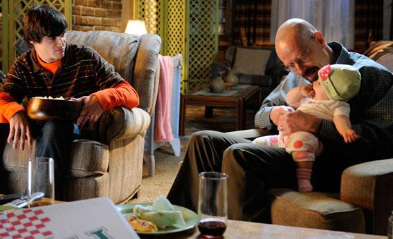 Walter White, Jr. (RJ Mitte) and Walter White (Bryan Cranston).