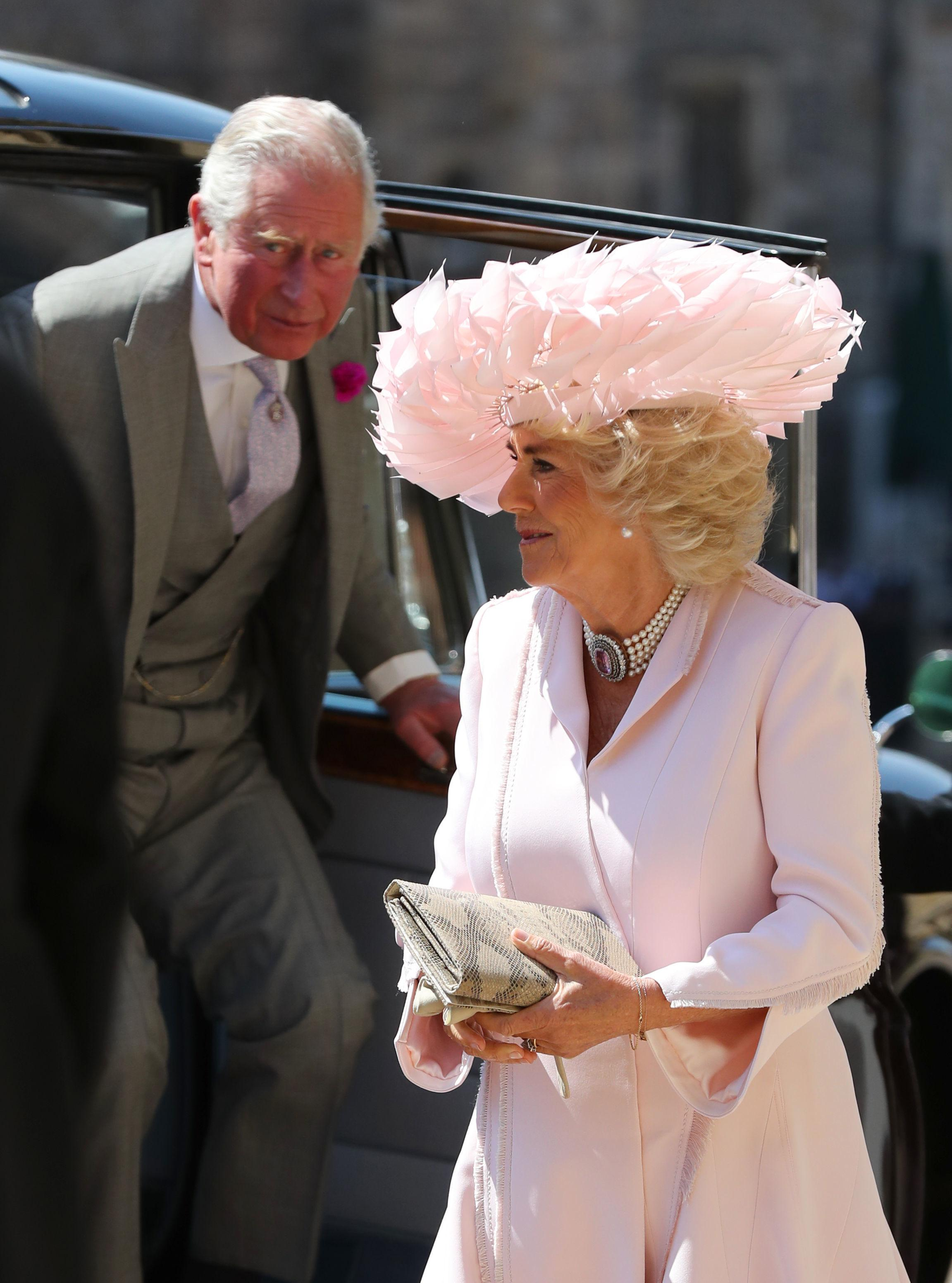 Camilla, Duchess of Cornwall arrives at St George's Chapel at Windsor Castle before the wedding of Prince Harry to Meghan Markle.
