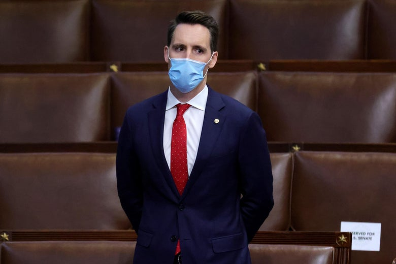 WASHINGTON, DC - JANUARY 06: Sen. Josh Hawley (R-MO) stands in the House Chamber during a reconvening of a joint session of Congress on January 06, 2021 in Washington, DC. Members of Congress returned to the House Chamber after being evacuated when protesters stormed the Capitol and disrupted a joint session to ratify President-elect Joe Biden's 306-232 Electoral College win over President Donald Trump. (Photo by Win McNamee/Getty Images)