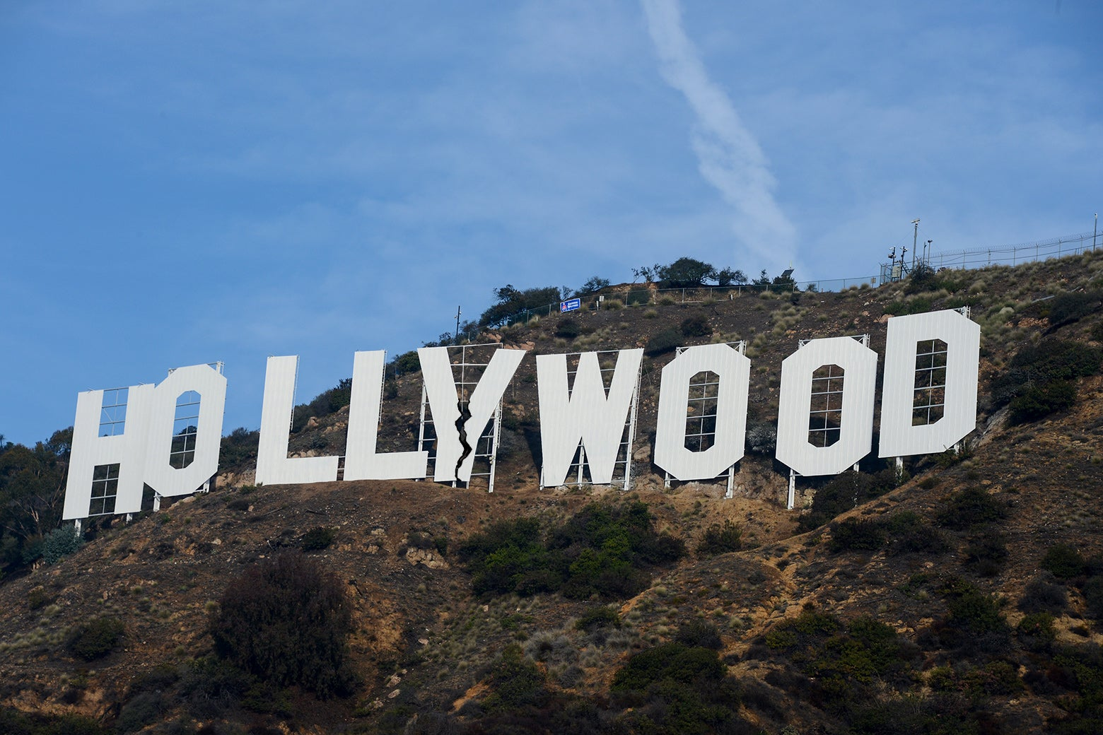 A picture of the Hollywood sign, with a schism down the middle.