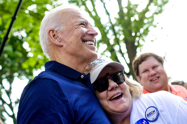 Biden hugging a smiling older woman outside