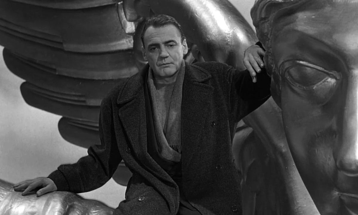 Bruno Ganz playing an angel in Wings of Desire.