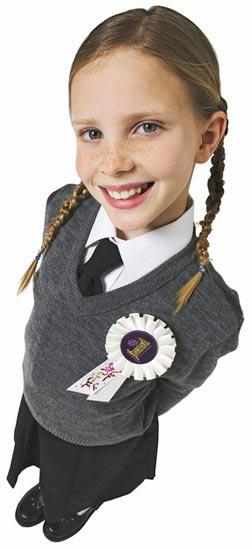 Girl wearing a 1st prize rosette.