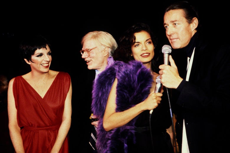 Liza Minnelli, Andy Warhol, Bianca Jagger, and Halston. Halston and Jagger hold microphones.