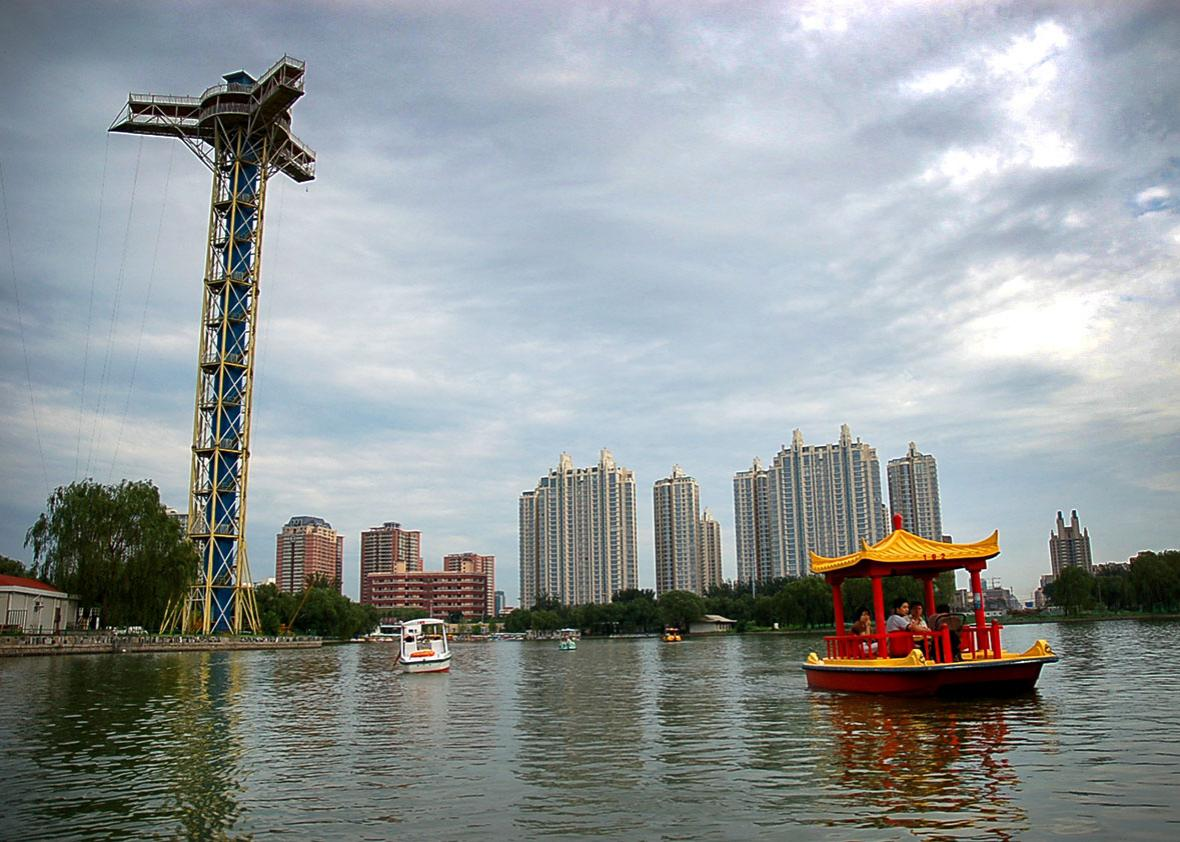 Boats float on Chaoyang Park's lake in the Chaoyang district of Beijing, China, July 5, 2008.