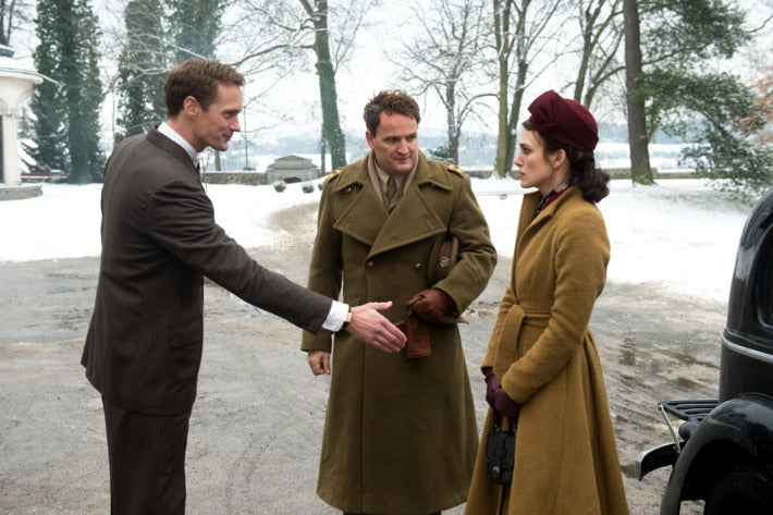 Alexander Skarsgård, Jason Clarke, and Kiera Knightley stand outside in winter.