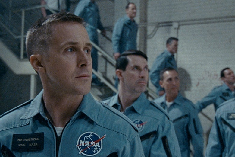 Ryan Gosling, Patrick Fugit, Shawn Eric Jones, and others wear uniforms with the NASA logo on them.