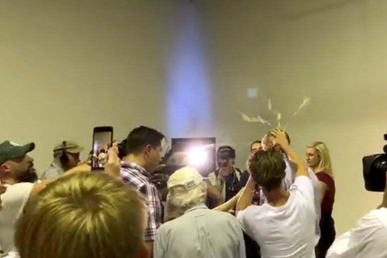 Australian Senator Fraser Anning has an egg smashed on his head while talking to the media in Victoria, Australia on March 16, 2019 in this still image taken from a video obtained from social media.