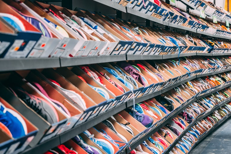 Rows of shoes in boxes on a rack in a store