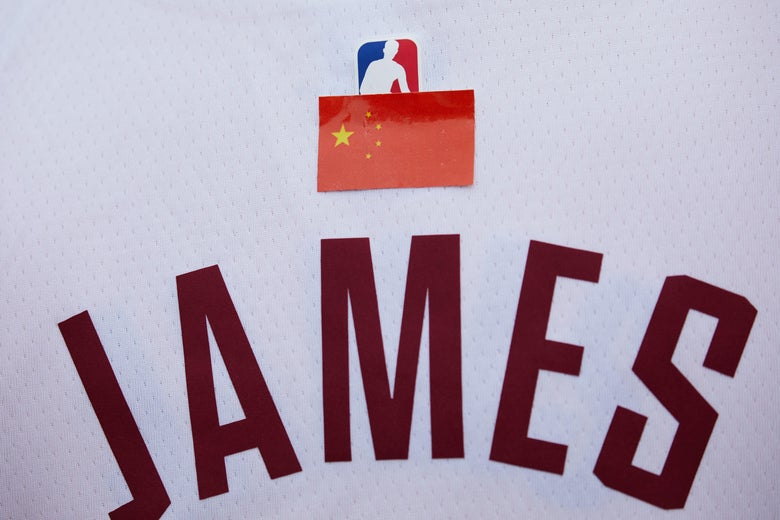 Close-up of the Chinese flag sticker over the NBA logo above the JAMES on a LeBron James jersey.