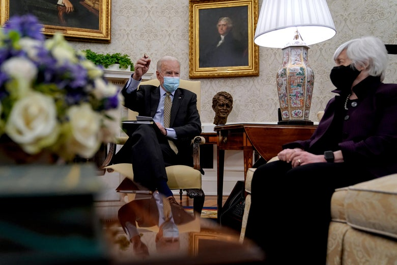 Joe Biden sits with Janet Yellen in the Oval Office, both wearing masks