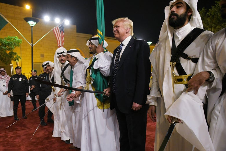 U.S. President Donald Trump joins dancers with swords at a welcome ceremony ahead of a banquet at the Murabba Palace in Riyadh on May 20, 2017.