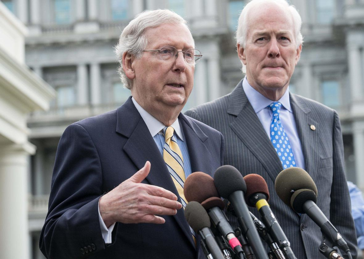 US Senate Majority Leader Mitch McConnell (L) and Majority Whip John Cornyn