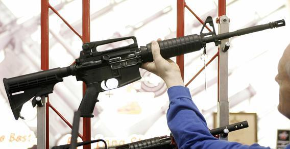Bill Saxler of Milwaukee holds a Bushmaster rifle in 2006, during the 135th National Rifle Association (NRA) Annual Convention in Milwaukee, Wisconsin.
