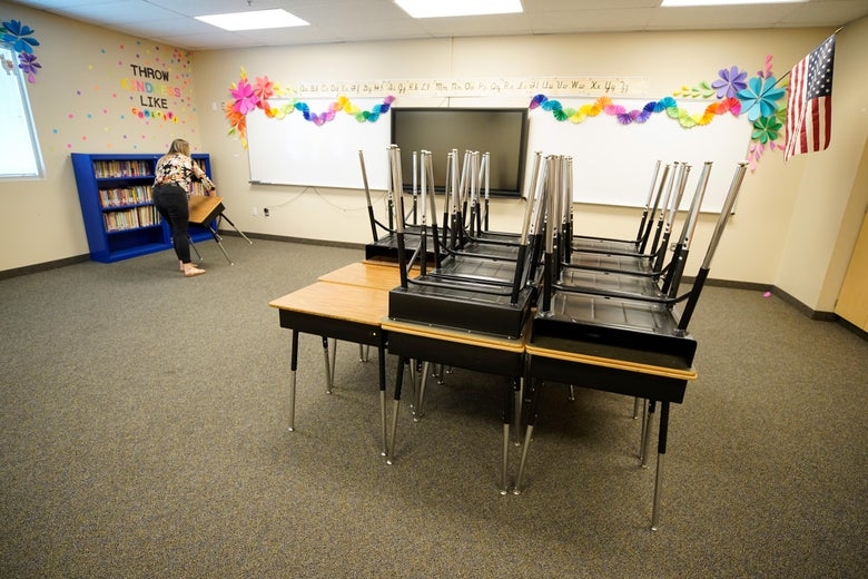 A teacher starts to reset up her classrooms with new rules on social distancing at Freedom Preparatory Academy as they begin to prepare to restart school after it was closed in March due to COVID-19 on August 5, 2020 in Provo, Utah.