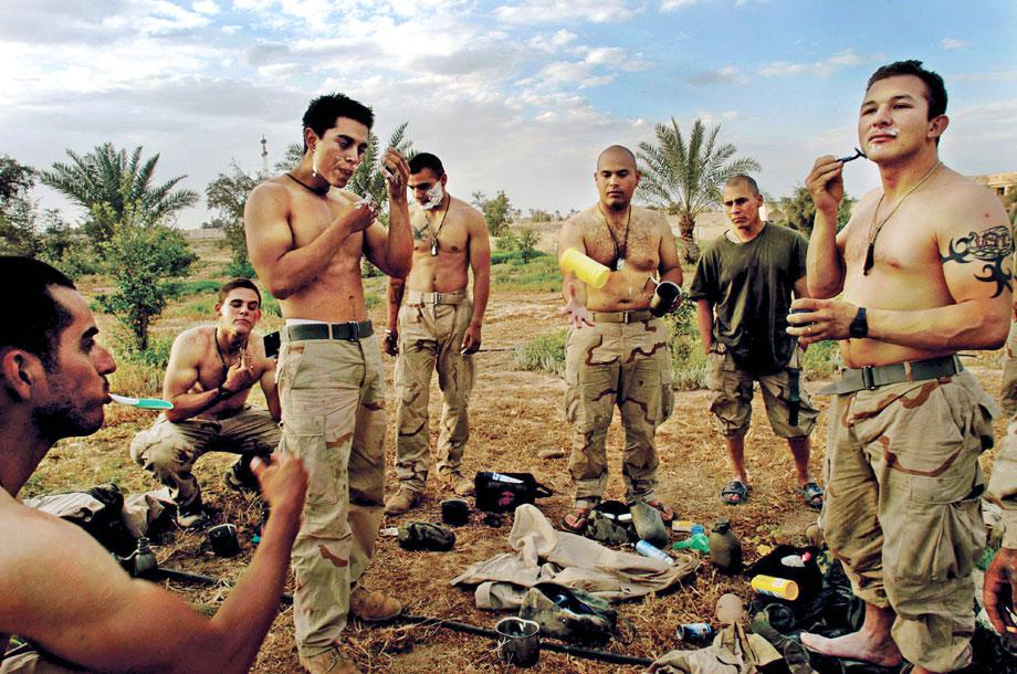 U.S. Marines take a break to shave in front of one of Saddam Hussain's presidential palaces the day Tikrit fell from Republican Guard rule, April 15, 2003.