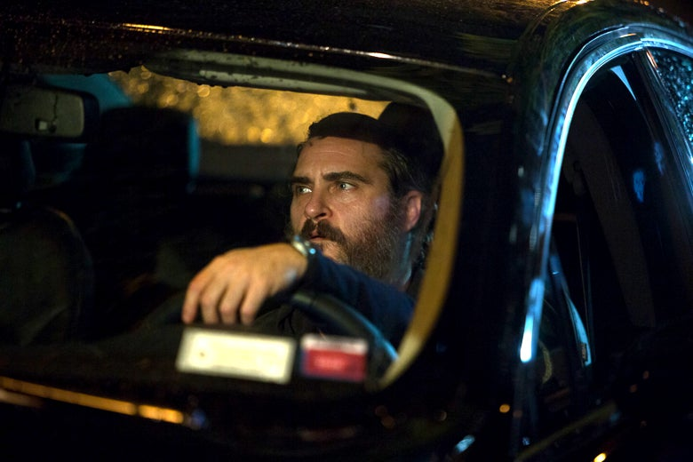 Joaquin Phoenix behind the wheel of a car in You Were Never Really Here.