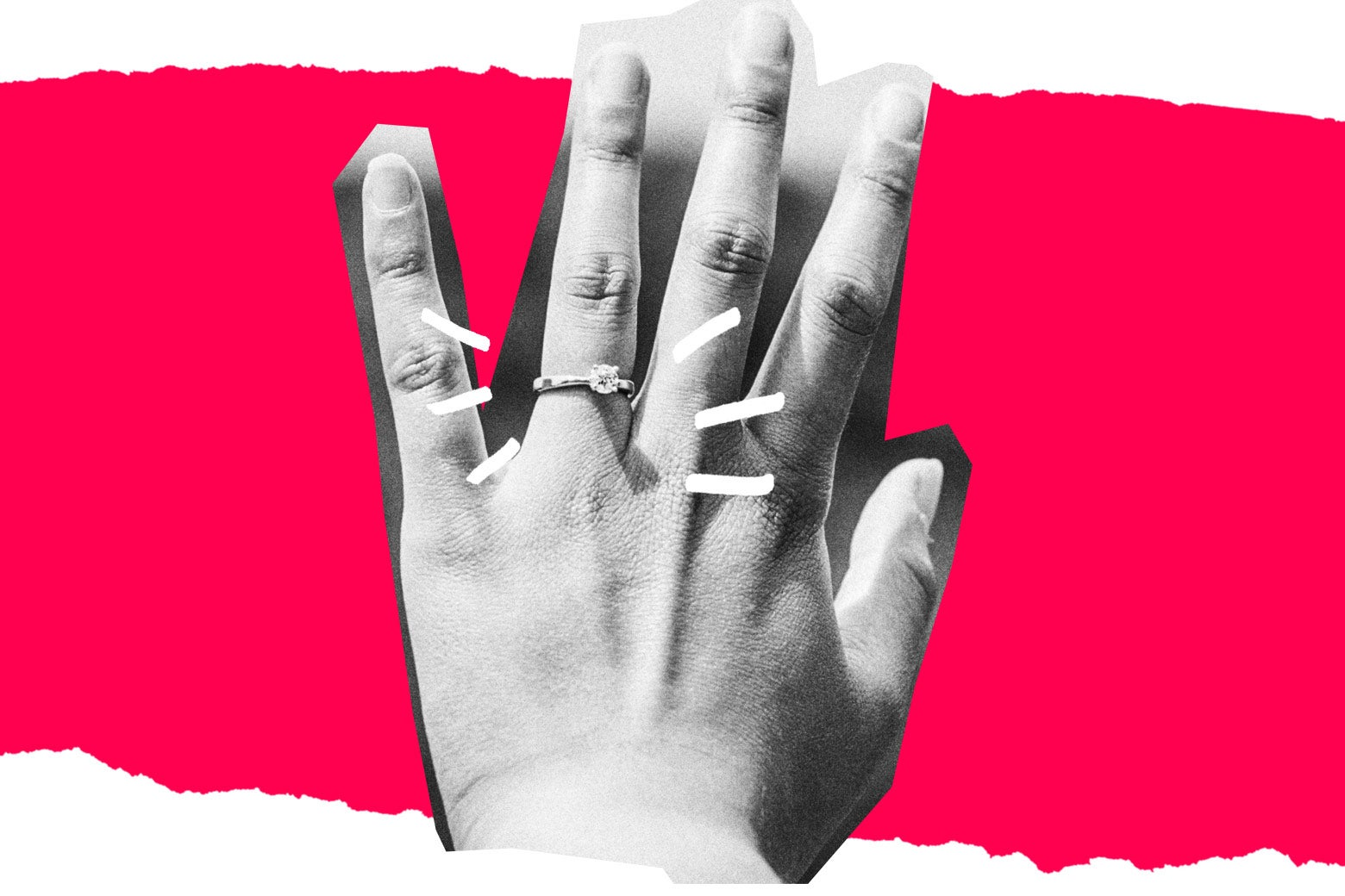 An engagement ring on an outstretched hand.