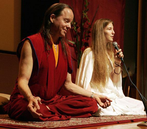 Geshe Michael Roach (L) and Christie McNally hold a yoga session at the Hong Kong Convention and Exhibition Centre, 02 June 2007.