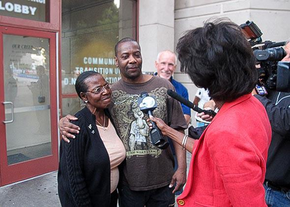 Kash Register and his mother, Wilma, speak to reporters immediately after his release from jail.