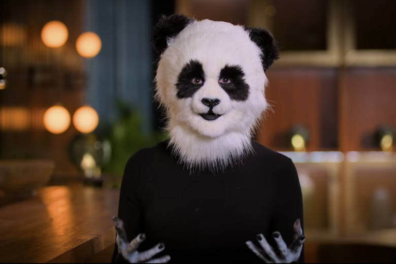 Woman in black shirt with a panda mask.