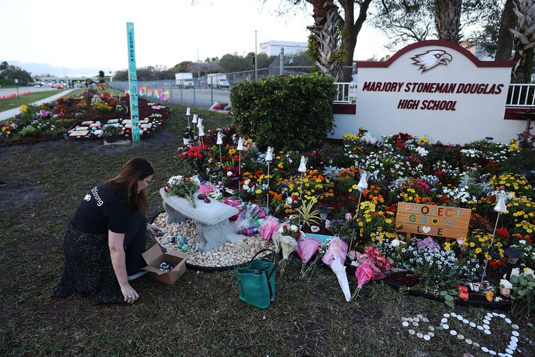 A memorial setup at Marjory Stoneman Douglas High School for those killed during a mass shooting in Parkland, Florida.